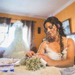 la novia con su ramo y el vestido de fondo fotografo bodas la linea algeciras tarifa